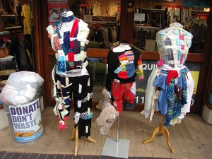 charity shop display of old clothes saved from landfill