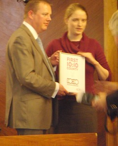 Cllr mark Hawthorne receiving the first 10:10 county award from Harriet Bell