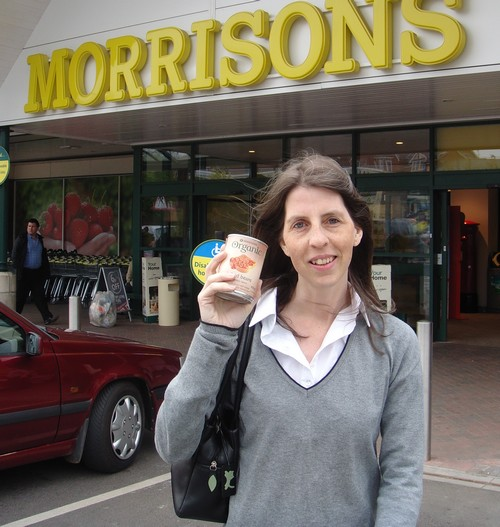 Mrs Green carries her tin of beans from Morrisons